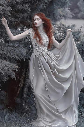 挽起裙子的红发美女艺术摄影