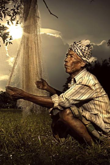 晒网的老渔民纪实摄影